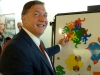 Sam Stanley, President of Stony Book University, enjoying our tessellating monkey magnets.