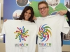 The cast of NCIS Los Angeles showing off their MoMath T-shirts