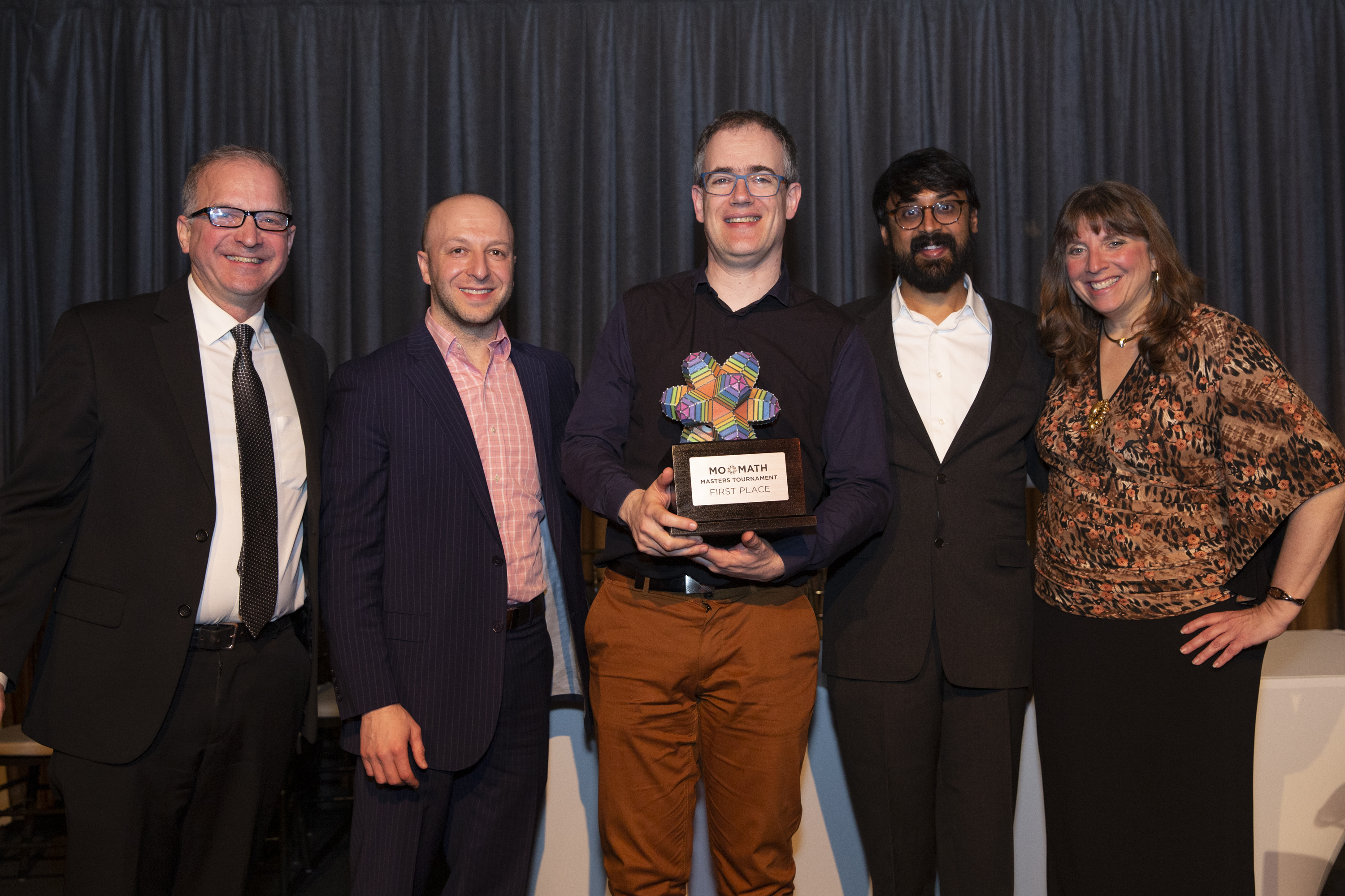 Associate Director Tim Nissen, Dean of Academic Content Alex Kontorovich, Fields Medalist and Distinguished Visiting Professor Manjul Bhargava, and Executive Director Cindy Lawrence with 2019 MoMath Masters tournament Champion Geva Patz