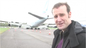 Man in front of airplane