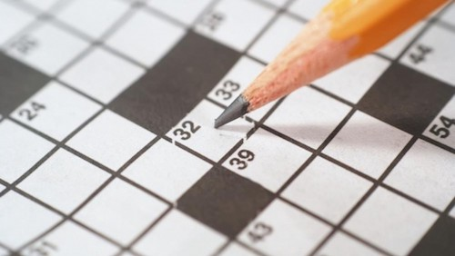 Pencil on a blank crossword puzzle