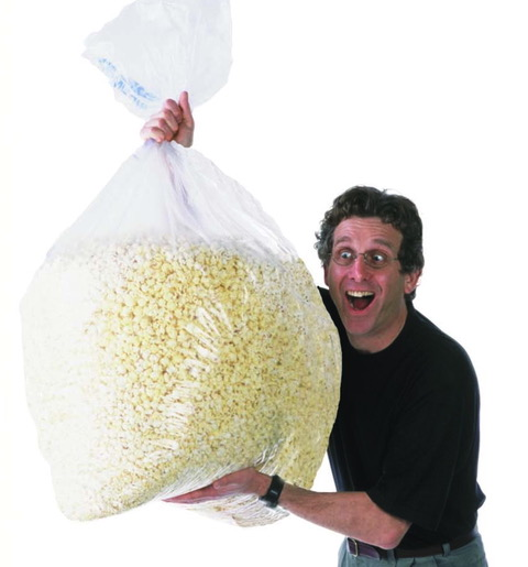 David Schwartz holding a giant bag of popcorn