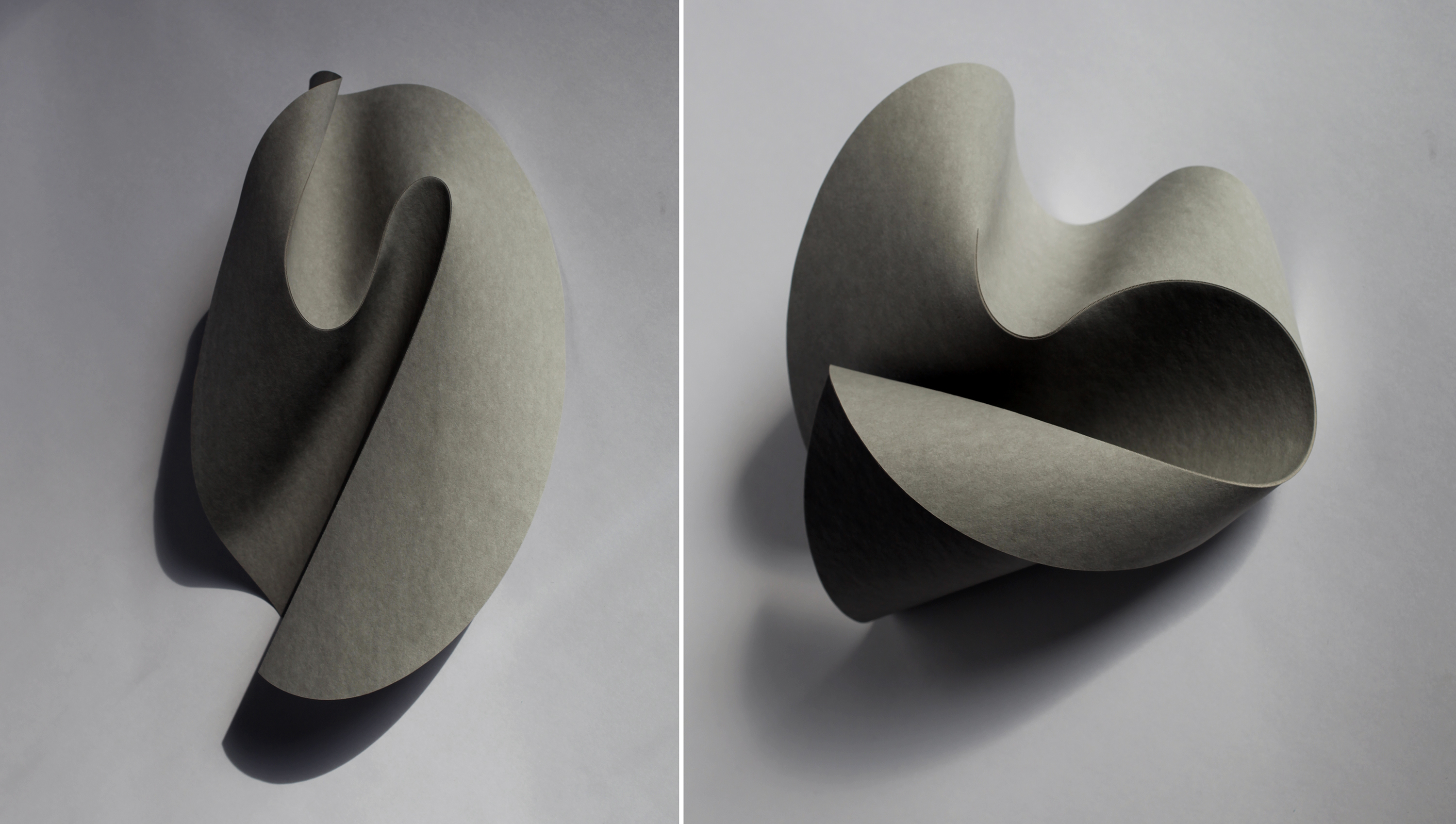 Two abstract curved sculptures