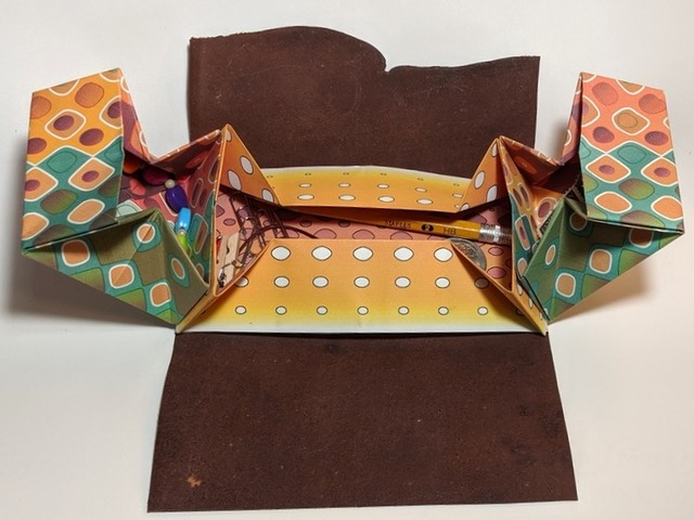 Origami box folding closed