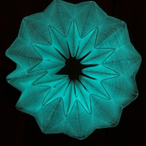Teal glowing star shape