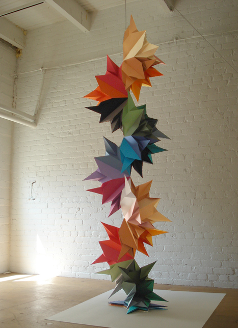 Tall, colorful origami sculpture
