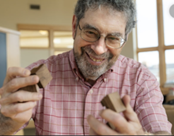 Peter Winkler holding blocks