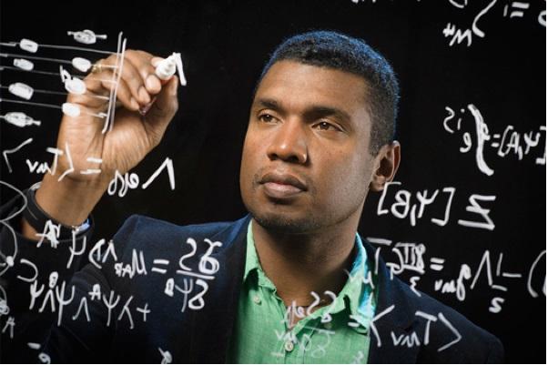 Stephon Alexander writing formulas on glass