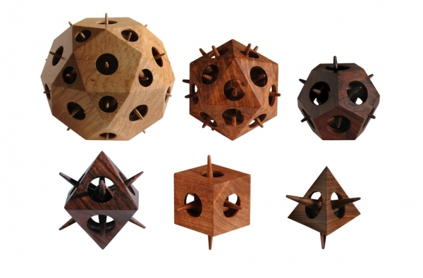a large icosidodecahedron and the five Platonic solids: icosahedron, dodecahedron, octahedron, cube, and tetrahedron